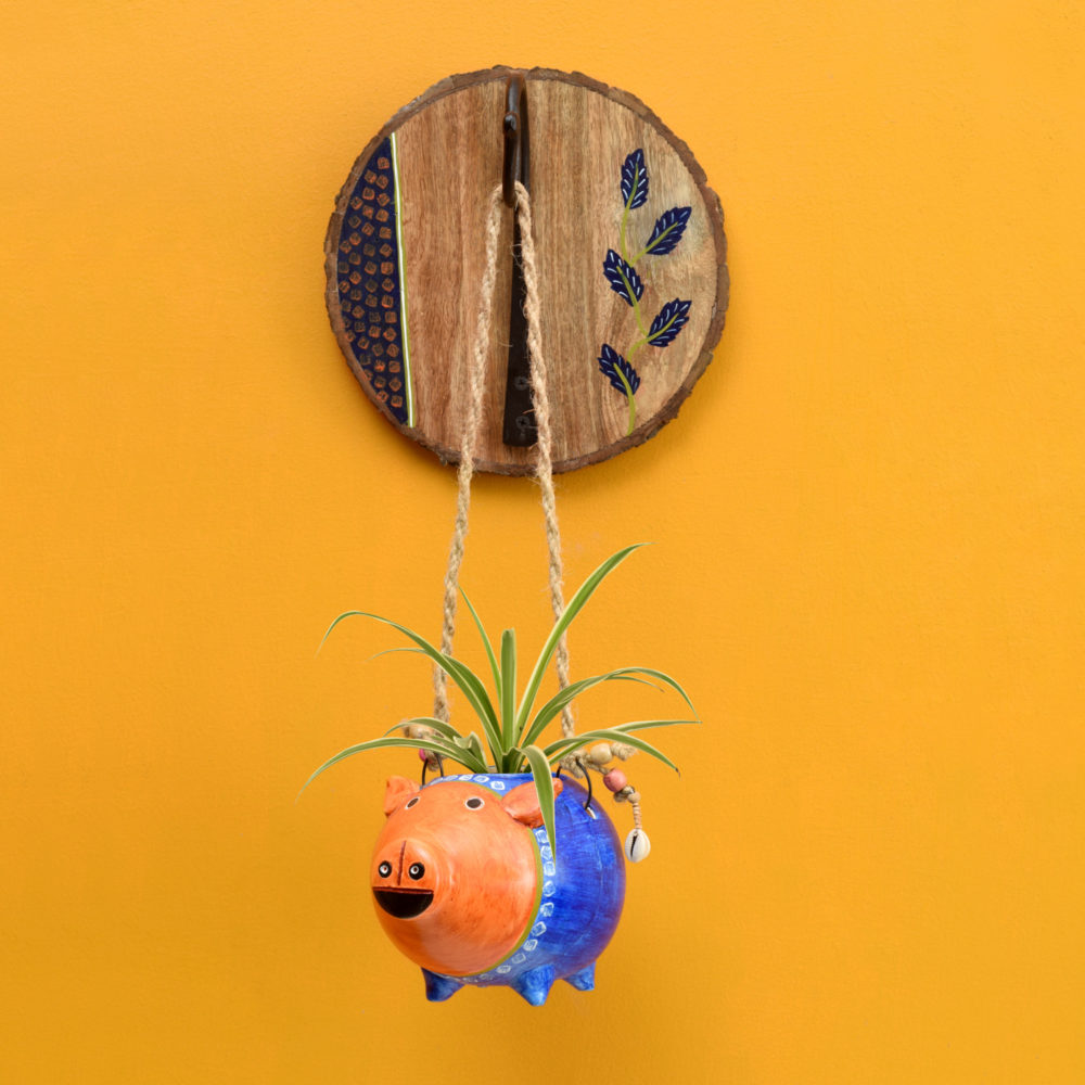 Blue Pig Earthen Planter on a Round Wall Hook